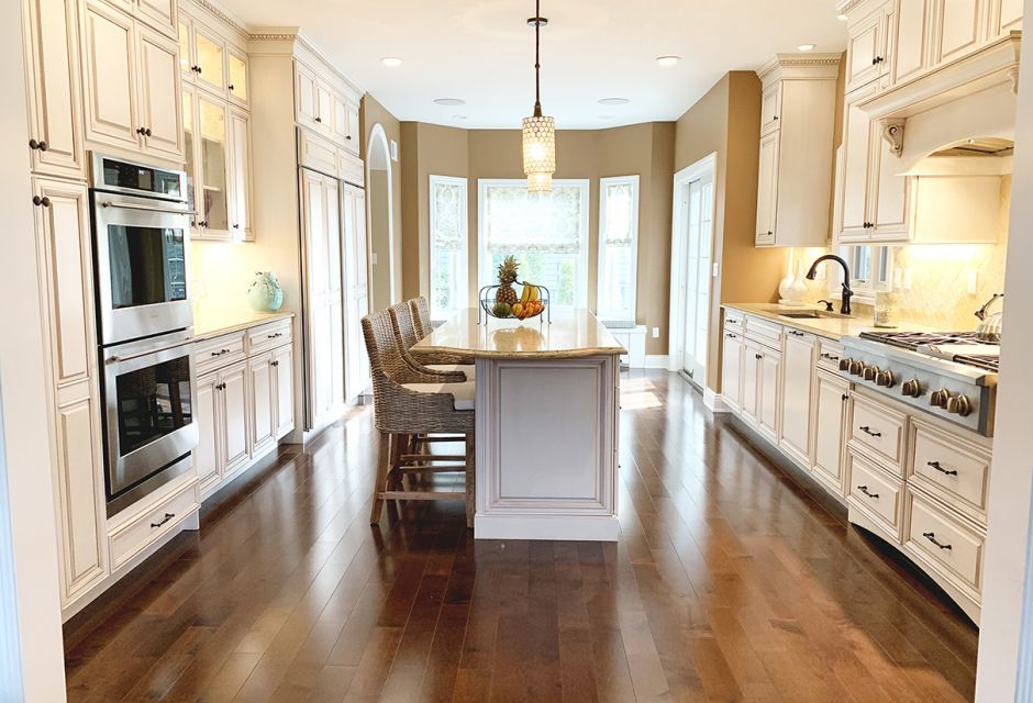 Sea Girt new construction home, multi-room project that Woodhaven designed, supplied and installed. Woodhaven Designer - Joe Tucci. Kitchen - Omega Cabinetry. Sanibel Door Style. Maple in Pearl Amaretto.